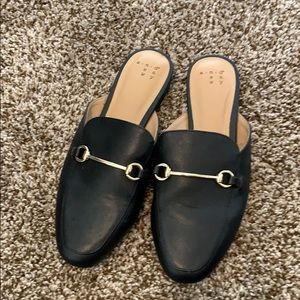 Black flats with gold accent